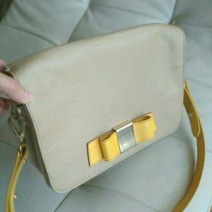 Ivanka Trump mustard yellow bowtie purse w strap